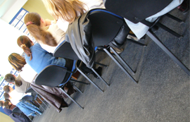 people sitting in a classroom attending a training session